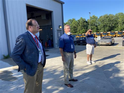 Dr. Nichols shown with Transportation Coordinator John Wilson at bus lot